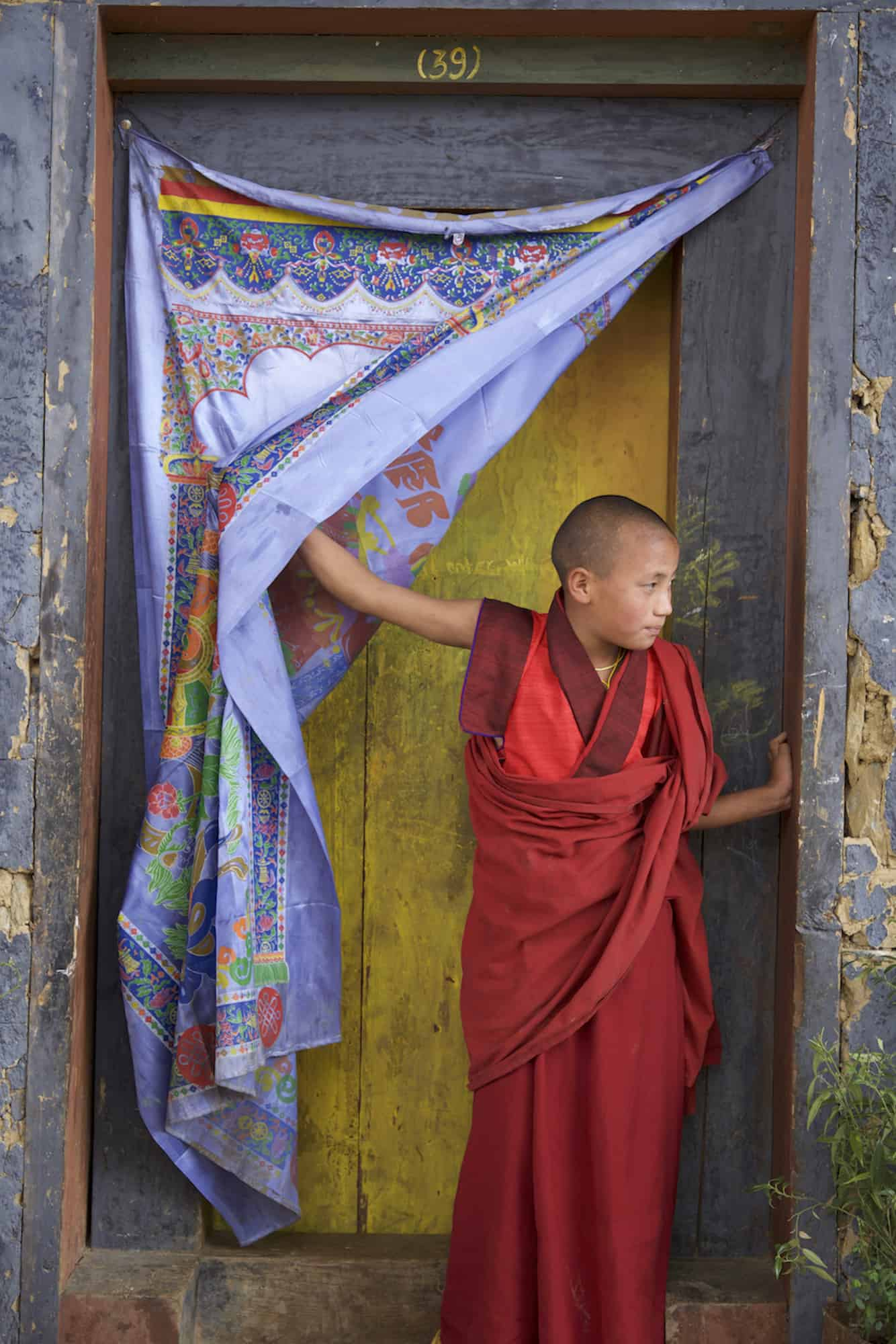 Photograph of a young monk in Bhutan